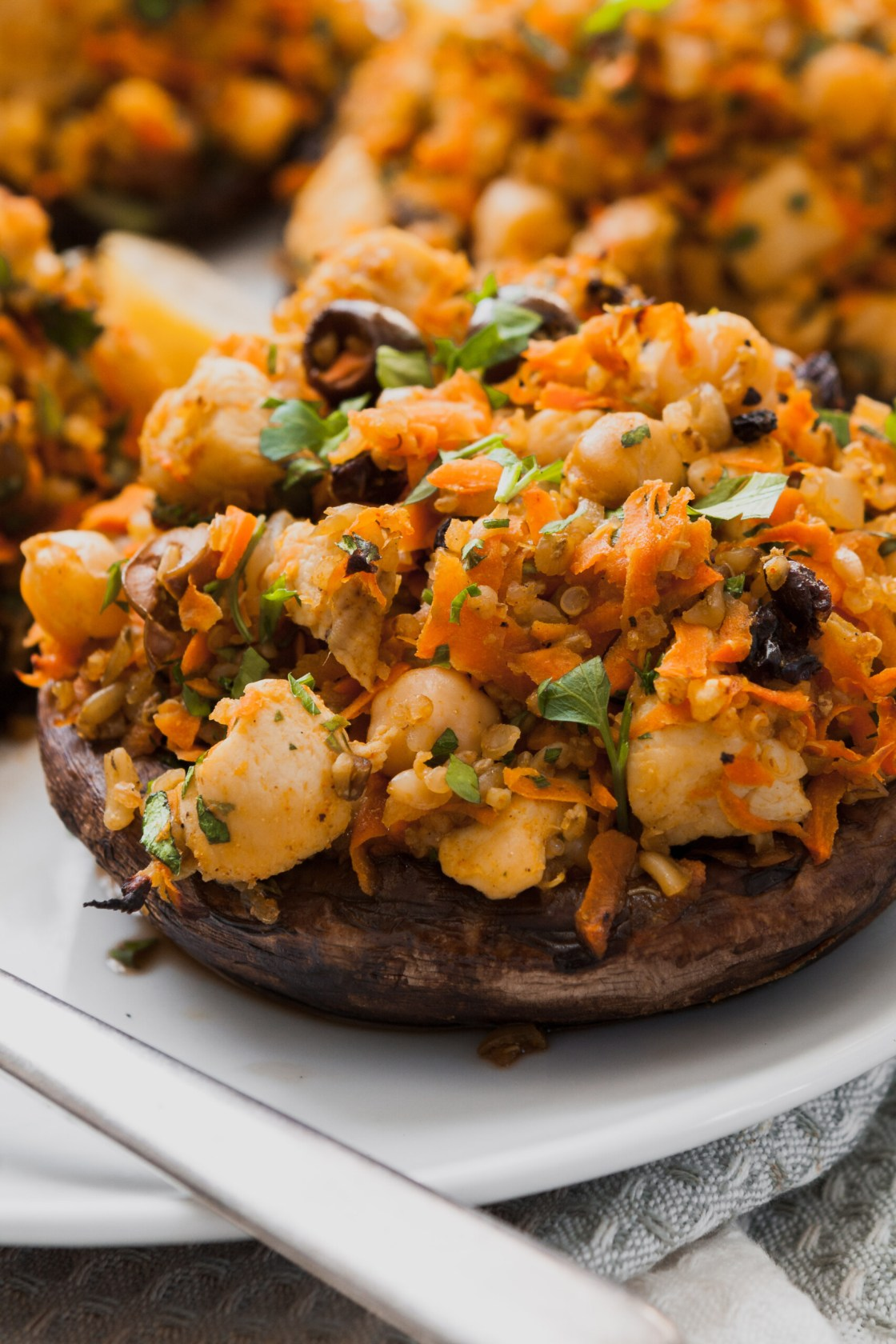 Packed with bold flavors and textures, these Moroccan Stuffed Portobellos with carrots, chickpeas, and ancient grains are not only healthy and satisfying, but easy to make and come together in under an hour! | from Lauren Grant of Zestful Kitchen