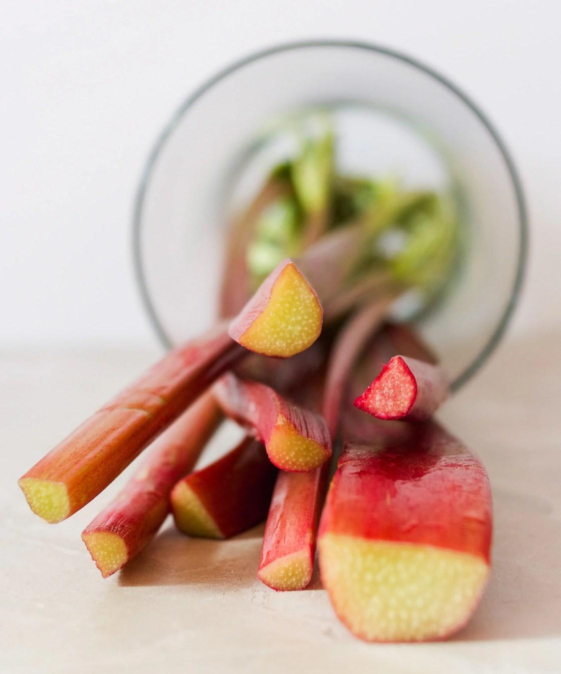 rhubarb stalks set on their side in a glass jar