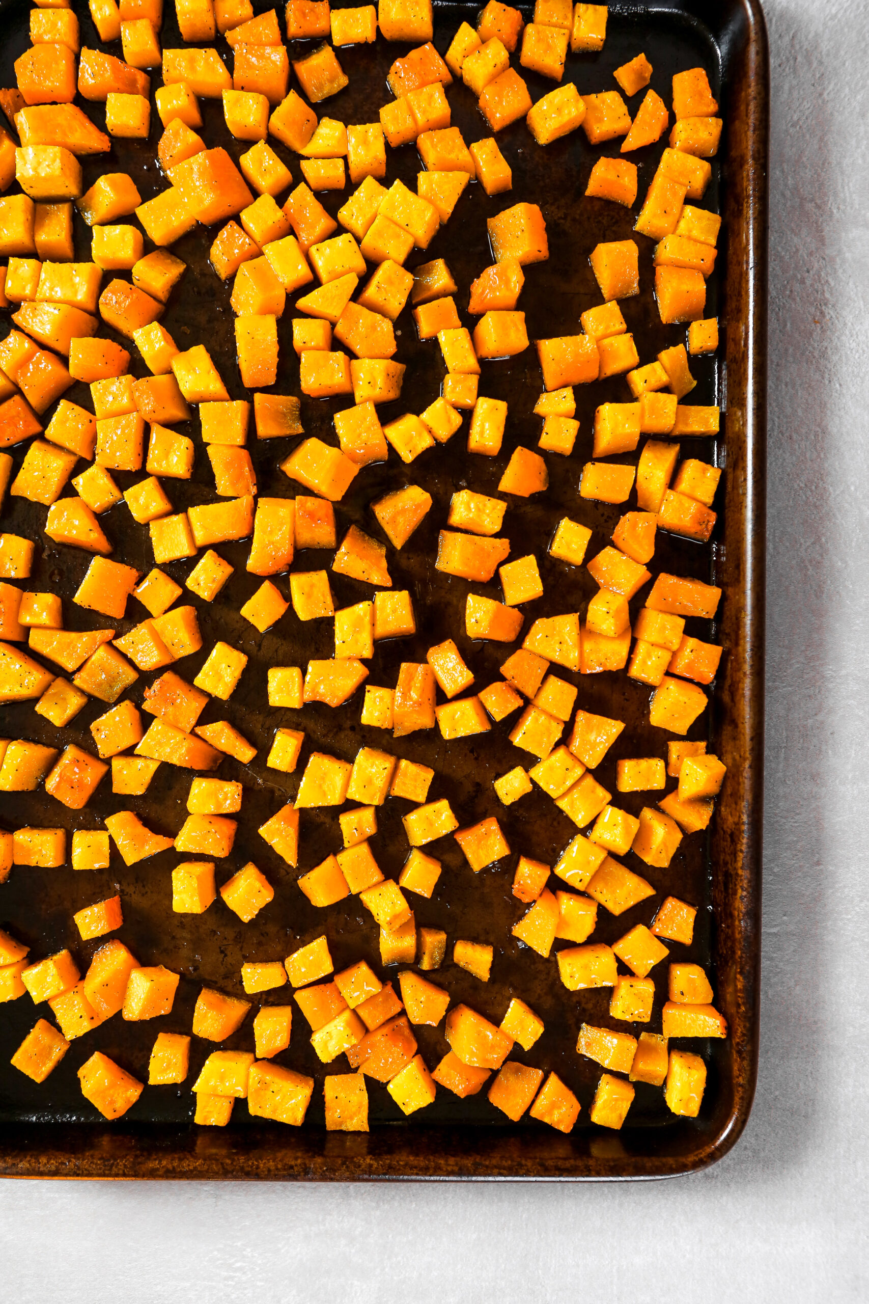 baking sheet with cubes of roasted squash