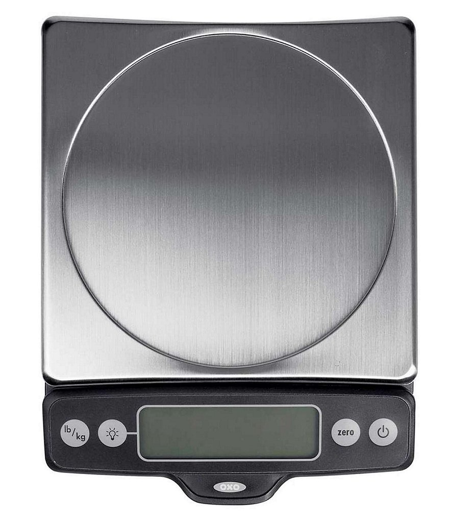Photograph of a digital scale on a white table