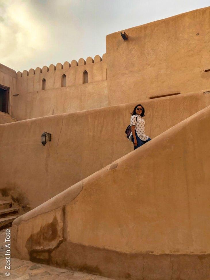 Nizwa-Fort-climbing-stairs