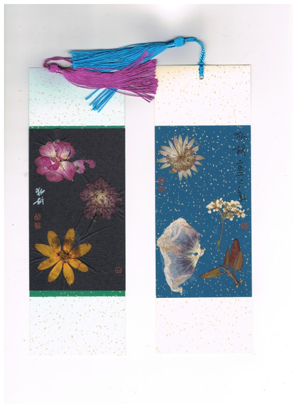 2 bookmarks made of dried blossoms and leaves