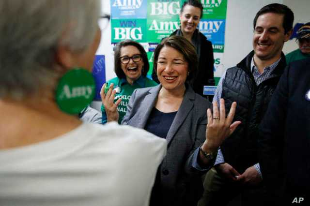 Democratic presidential candidate Sen. Amy Klobuchar, D-Minn., reacts while meeting supporters at a campaign office, Saturday,…
