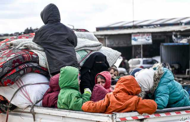Civilians flee from Idlib toward the north to find safety inside Syria near the border with Turkey, Feb. 15, 2020. Syrian troops are waging an offensive in the last rebel stronghold.