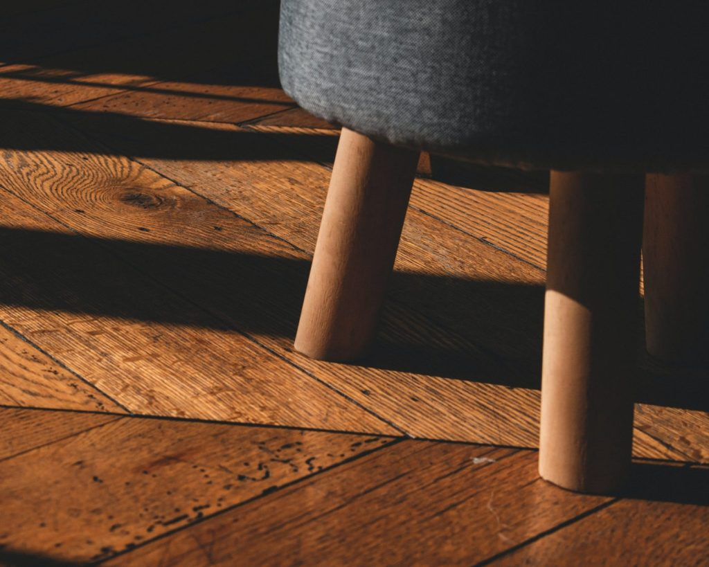 hardwood flooring black round seat on brown wooden floor