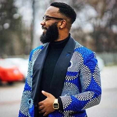 Shammah Musiq wearing a suit