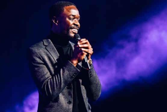 Nelson T Gombakomba Jr holding a mic