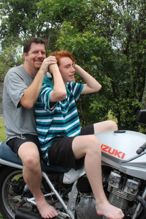 Father and teenage son on Katana motorcycle. Su Leslie, 2016