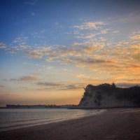 Taking a walk along the beach at sunset