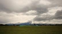 Mt Taranaki shrouded in cloud. Seen at Opunake Beach, Taranaki, NZ. Image: Su Leslie, 2017