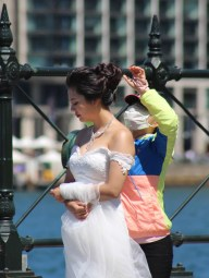 Bride being prepared for her wedding photo shoot, Circular Quay, Sidney, Australia. Image: Su Leslie, 2015