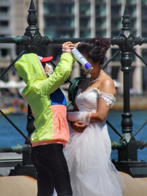 Bride being prepared for her wedding photo shoot, Circular Quay, Sidney, Australia. Image: Su Leslie, 2015