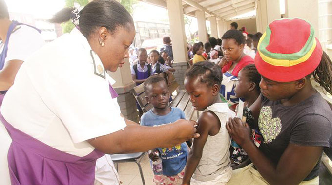 MASS TYPHOID VACCINATIONS BEGIN