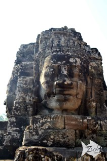 The Bayon is best known for the mysterious faces on its many towers. Due to its many alterations over time, the structure is of a very complicated design and has a cluttered feel, with the many towers and other structures cramping the monument.