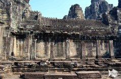 Unlike most Khmer temples, the Bayon is not surrounded by a moat and walls with gopura entrance gates. Archaeologists believe that instead the moat and walls of Angkor Thom served as the temple's line of defense.