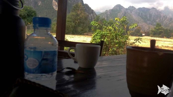 Morning coffee at our hut's balcony at the Riverside Garden Bungalows.