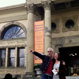 Man pointing with woman on the stairs of the Petaluma Historical Library and Museum