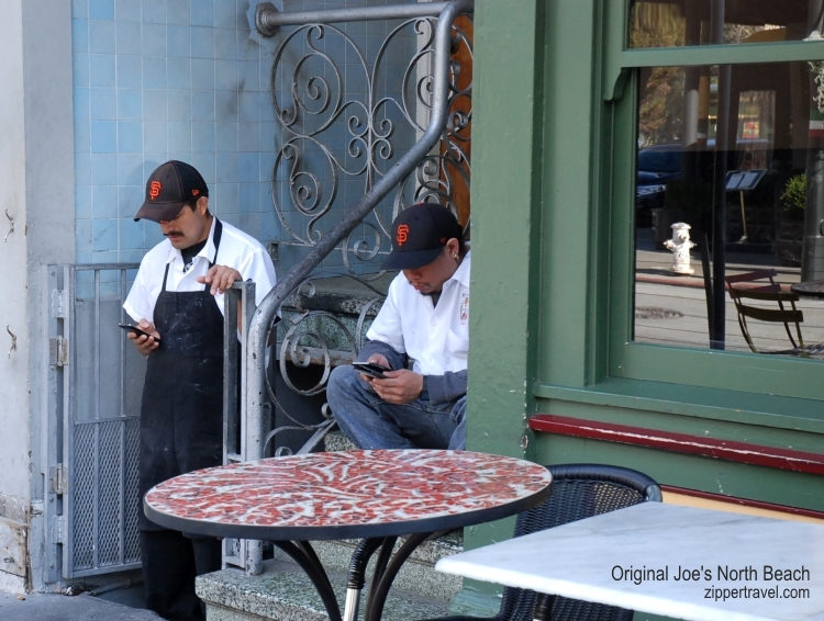 Worker's cell phone check Original Joes North Beach San Francisco California