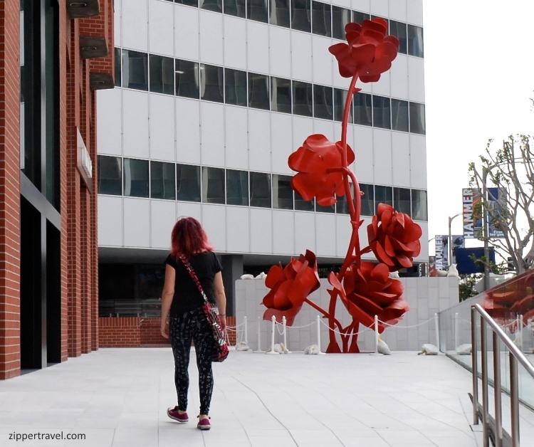 red roses sculpture red haired girl westwood los angeles