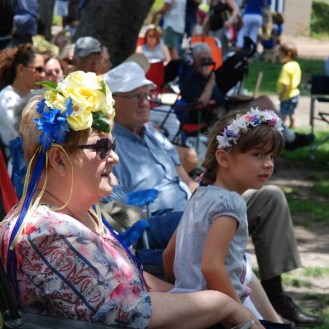 Crowd woman child flower headdresses Balboa Park San Diego