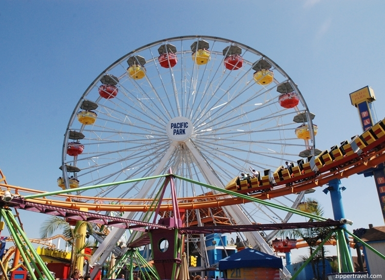 Roller coaster against Ferris wheel Santa Monica California