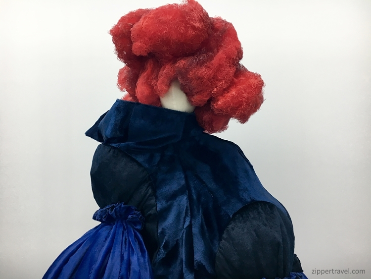 Red hair blue dress Rei Kawakubo Metropolitan Museum