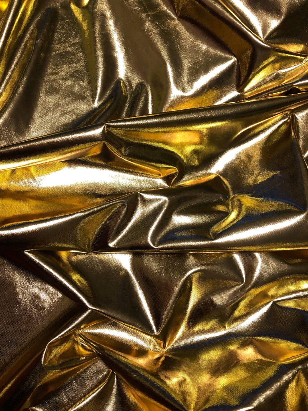 Gold foil fabric bunched up