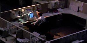 Man sitting in creepy office alone