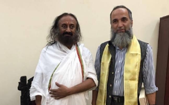 Sri Sri Ravi Shankar and Muzaffar Wani. Sri Sri Ravi Shankar and Muzaffar Wani, father of slain Hizbul Mujahideen commander Burhan.