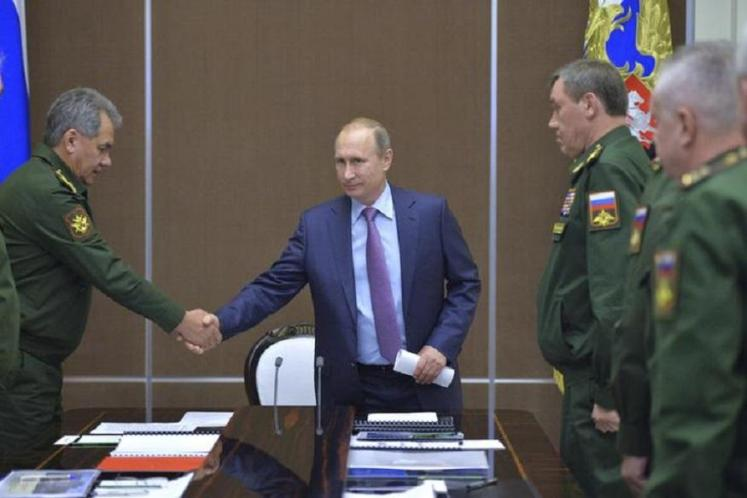 Russian President Vladimir Putin (2nd L) shakes hands with Russian Defence Minister Sergei Shoigu during a meeting at the Bocharov Ruchei state residence in Sochi, Russia, November 10, 2015. Russia was working on weapons systems to get around any anti-missile shields, President Vladimir Putin told a meeting on the defense industry on Tuesday. (Image: REUTERS/Aleksey Druzhinin/RIA Novosti/Kremlin)