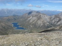 Lake Lyndon from Foggy Peak, with Aoraki/Mt Cook now visible - the distant snowy ridge below the righthand end of the darker, lower clouds