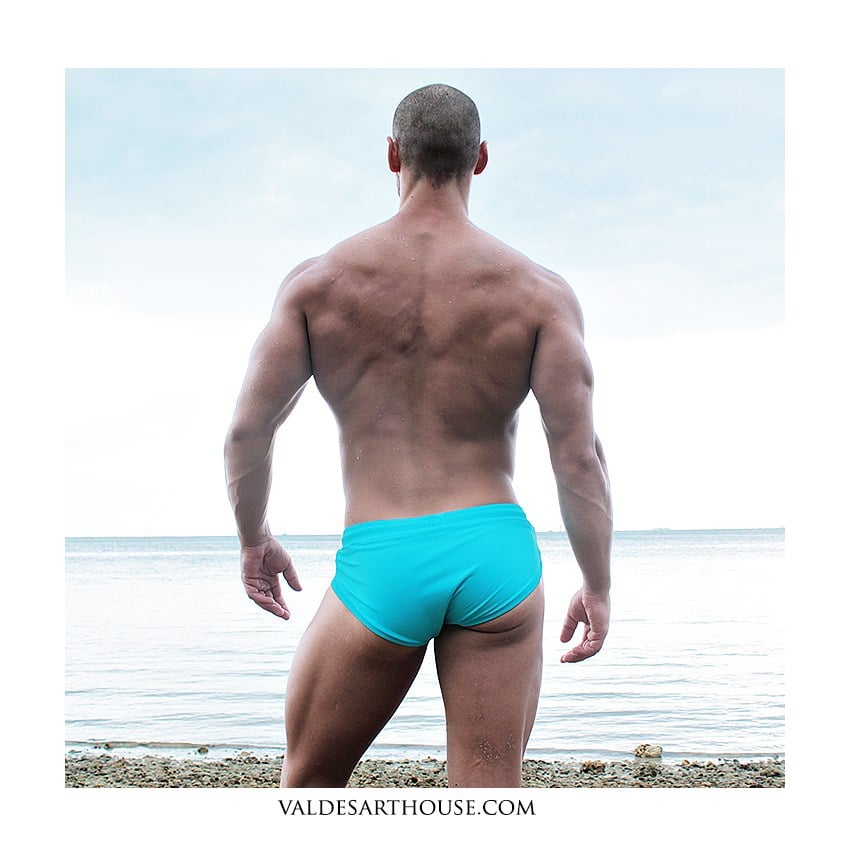 Worn by Eric, turquoise swimwear from ZLC.
