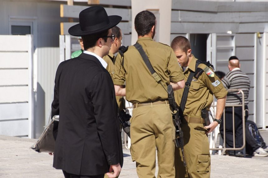 Israeli soldiers and a local