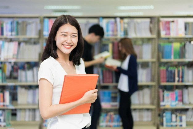 Giao duc New Zealand thuoc top dau the gioi ve phat trien ben vung hinh anh 2 group_asian_students_studying_together_library_university_73503_1269.jpg