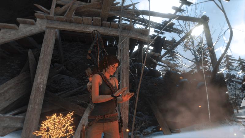 Lara wärmt sich am Lagerfeuer