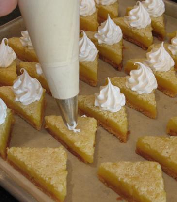 Piping meringue onto lemon bars | ZoëBakes | Photo by Zoë François