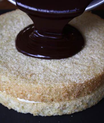 Pouring chocolate glaze on Boston cream pie | ZoëBakes | Photo by Zoë François