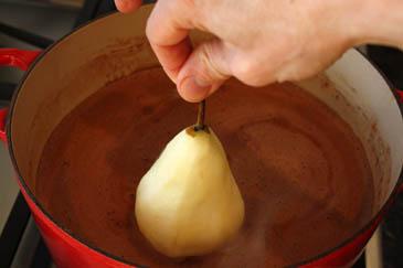 Adding pears to poaching liquid | ZoëBakes | Photo by Zoë François