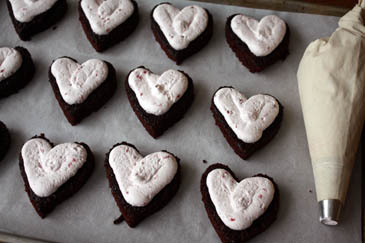 Filling the chocolate heart-shaped cakes with raspberry cream