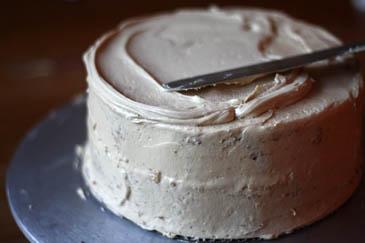 Spreading icing on marble cake | ZoëBakes | Photo by Zoë François