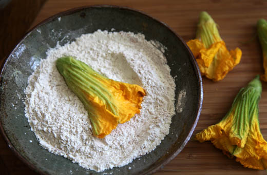 Stuffed squash blossom in flour coating for frying | ZoëBakes | Photo by Zoë François