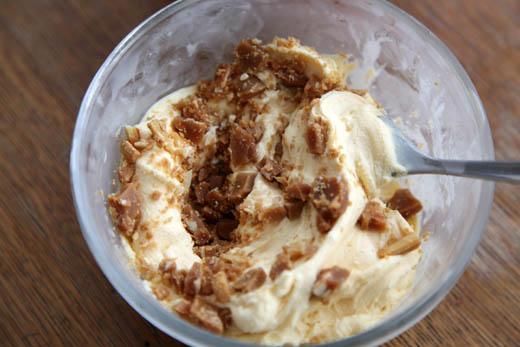 Mixing brittle into vanilla ice cream | ZoëBakes | Photo by Zoë François