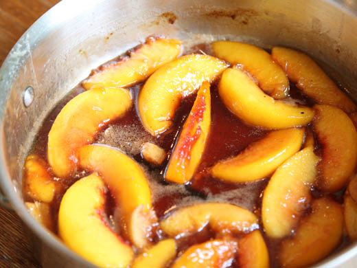 Cooking down peaches for upside down cake | ZoëBakes | Photo by Zoë François