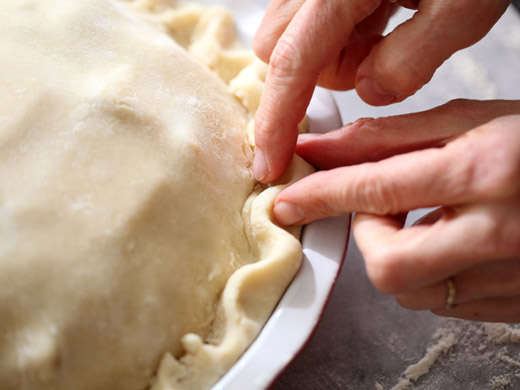 Crimping the edges of the best apple pie crust | photo by Zoë François