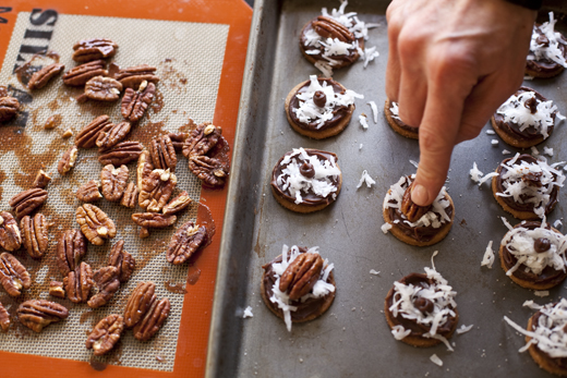 Placing pecans on chocolate covered graham crackers | ZoëBakes | Photo by Zoë François