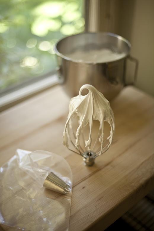 Whipped meringue on whisk | ZoëBakes | Photo by Zoë François