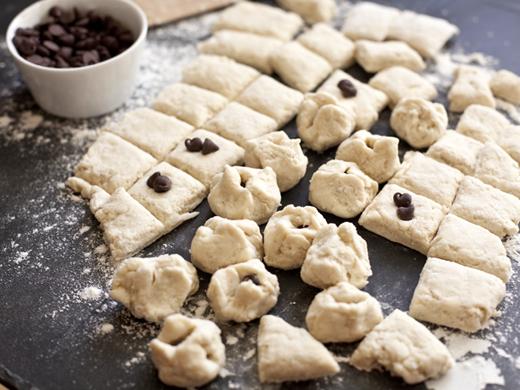 Slicing dough for monkey muffins | ZoëBakes | Photo by Zoë François