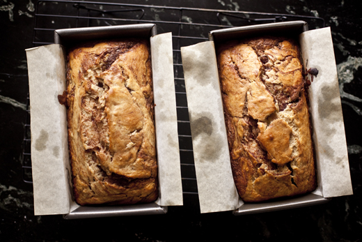 Nutella Swirled Banana Bread recipe - two loaves cooling on a wire rack | photo by Zoë François