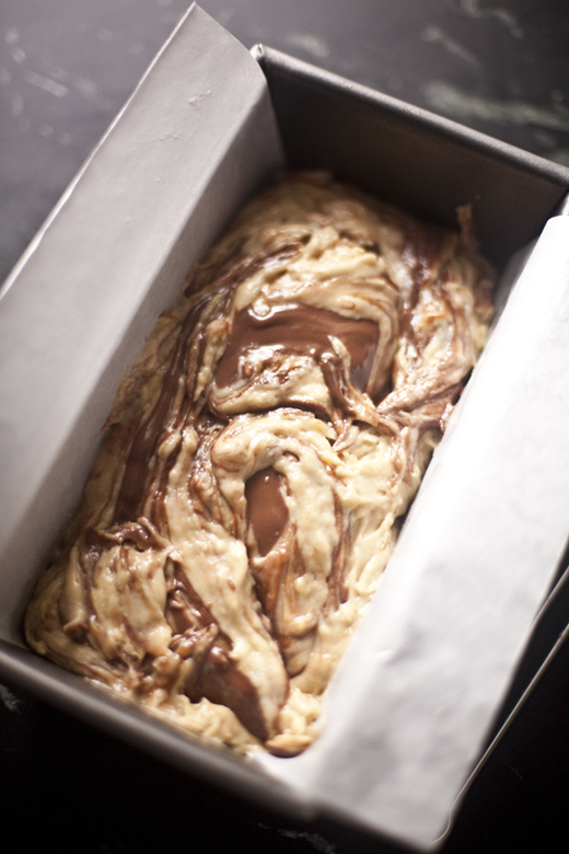 Nutella Swirled Banana Bread recipe - adding the rest of the Nutella and swirling it into the batter | photo by Zoë François
