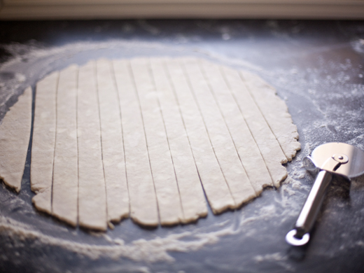 A circle of pie dough rolled out and cut into strips for lattice.